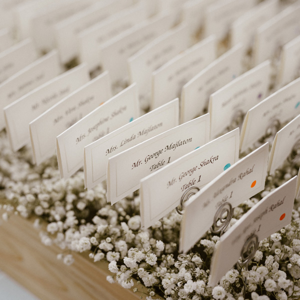 Bee Inspired Events - Baby's breath and wooden box for place cards table